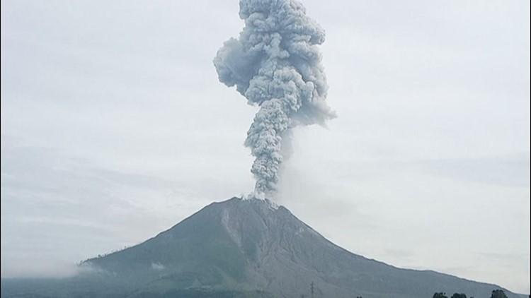 Indonesian volcano spews ash and debris