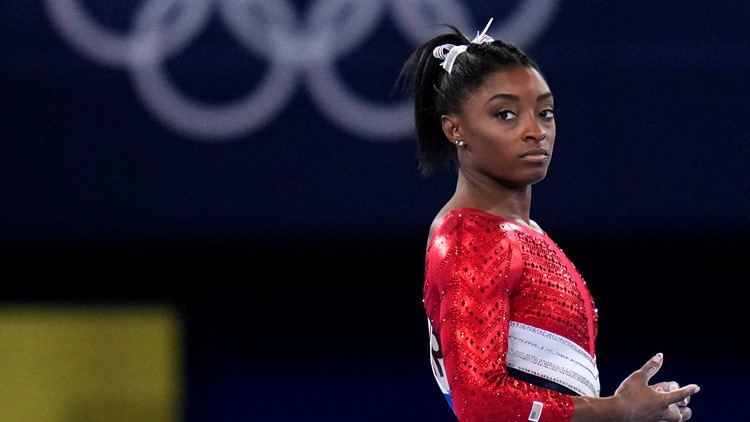 Olympic champ Biles withdraws from all-around competition
