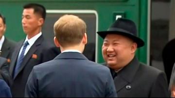 North Korea's Kim upbeat as he arrives for Putin summit
