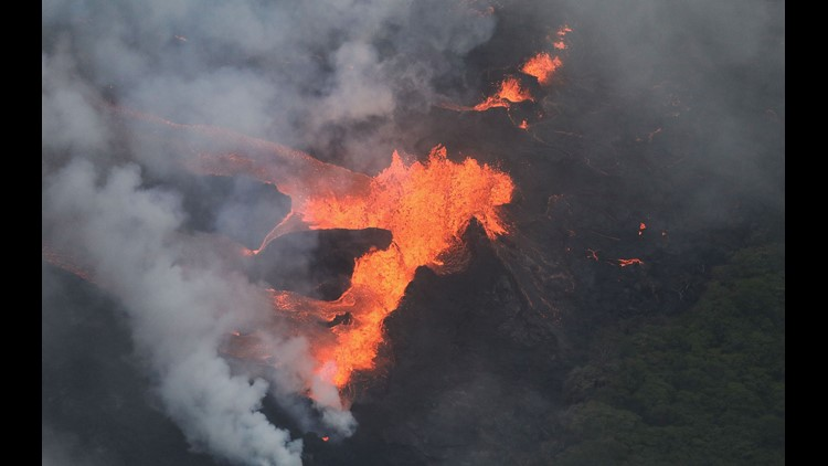 Hawaii volcano reaches ocean, jungles, threatens geothermal plant