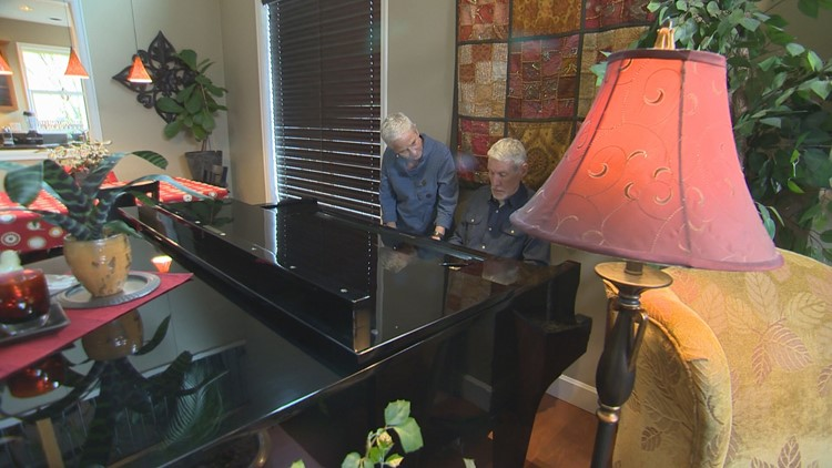 Steve and Joni Goodwin at their Wilsonville home playing the piano.