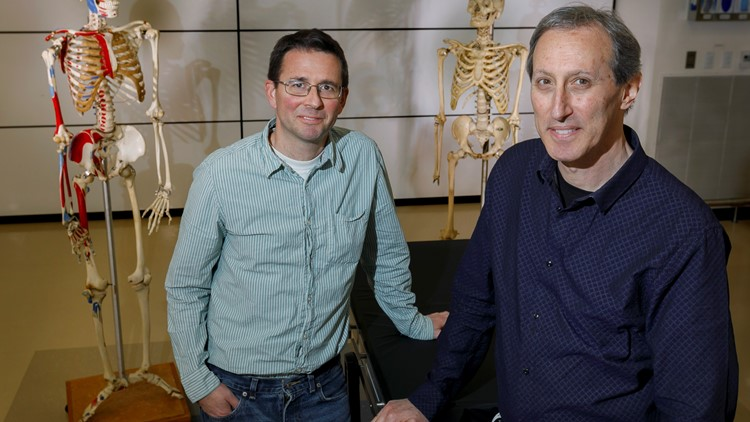 Cam Walker, Ph.D. (left) and Mark Hankin, Ph.D., researched a rare case of situs inversus with levocaria, discovered in the body of a 99-year-old woman who donated her body for to OHSU.