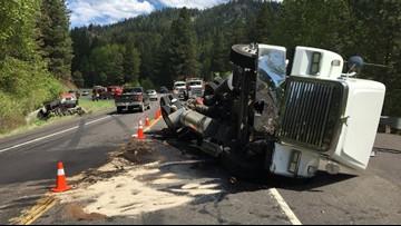 10,000 gallons of liquid asphalt spill in semi crash