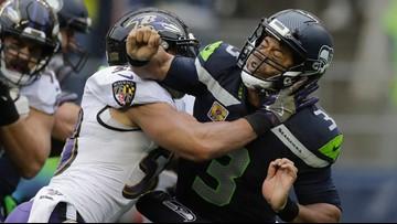 Ravens roll past Seahawks, 30-16 on a rainy Seattle Sunday
