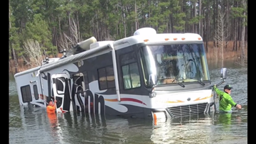 Dog puts Tennessee fisherman's RV in reverse, backs it into lake