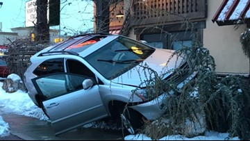 SUV appears to crash into North Spokane Tomato Street, police investigating