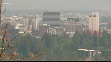 Why does Spokane attract smoke from Ferry County?