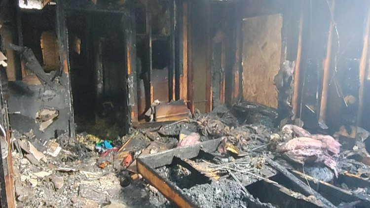 'It takes some of the pain away': Firefighters bring gifts to Rathdrum family who lost house in fire