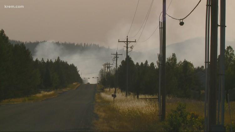 Trestle Creek fire grows, evacuations lowered
