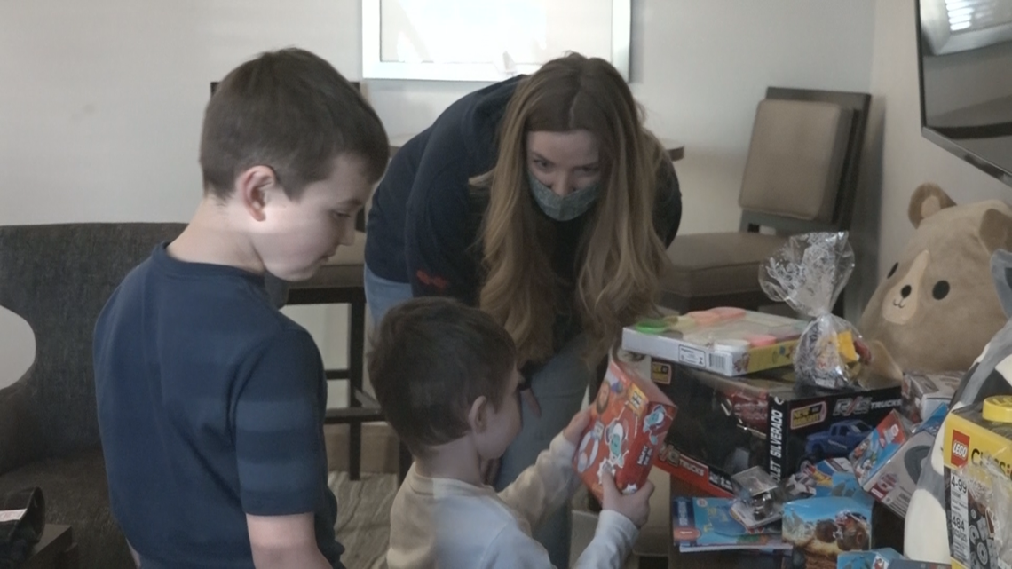 Firefighters bring gifts to Rathdrum family who lost house in fire
