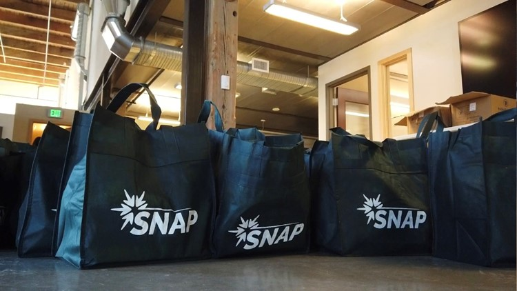 SNAP distributes energy conservation bags to help Spokane families save on utilities