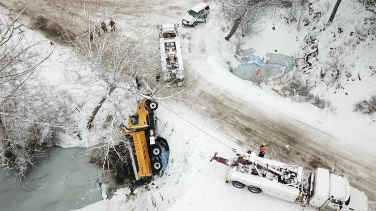 Snow plow tips on its side, leaks fuel into Salmon Creek