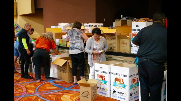 Hundreds of backpacks handed out for Tools 2 Schools 2016