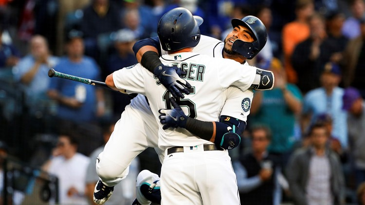Nelson Cruz homered twice and the surprising Seattle Mariners overcame Mike Trout's two home runs to beat the Los Angeles Angels 5-3 on Monday night.