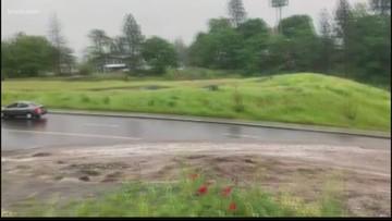 Flood waters cause minor landslide, blocking TJ Meenach Drive in both directions