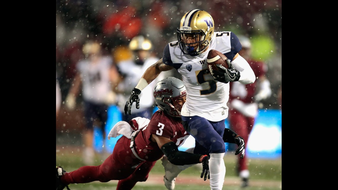 ... NOVEMBER 23  Andre Baccellia  5 of the Washington Huskies carries the  ball against Darrien Molton  3 of the Washington State Cougars in the first  half ... 21cc05fc7