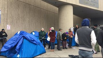 Protesters chained together at Spokane city hall in response to homeless eviction notice