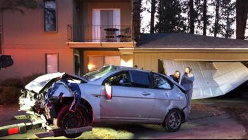 Car crashes into Spokane Valley home, parked truck and telephone pole