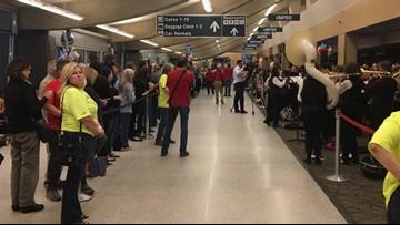 100 veterans on Inland Northwest Honor Flight get warm welcome home