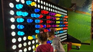 Avista electricians volunteer to build giant Lite Brite for Mobius Children's Museum