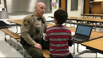 Hayden resource officer comforts boy struggling to get to school on time