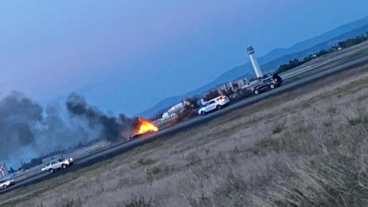 Bystanders save woman from burning car in Spokane