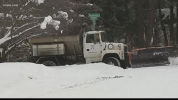 Spokane plow drivers as they work to clear snowy roads