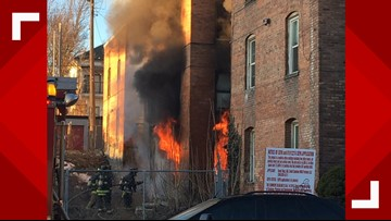 Firefighter injured, residents displaced after downtown Spokane apartment fire