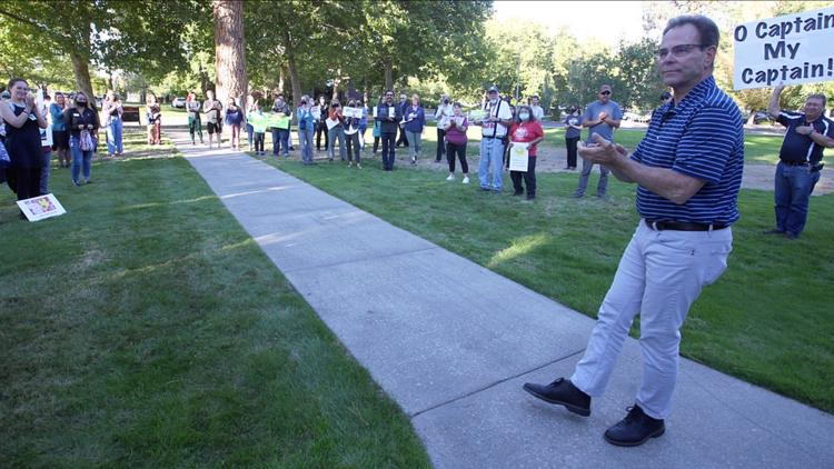 Despite North Idaho College board's vote to fire president, crowd cheers for him on last day
