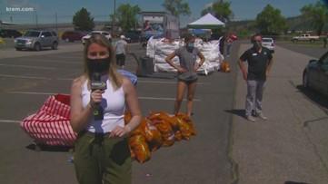 Farmers give away 100,000 pounds of potatoes at Spokane fairgrounds