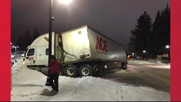 Semi-truck cleared after sliding into South Spokane parking lot
