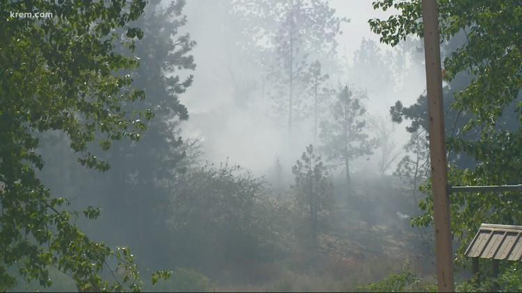 Growing brush fire burning along I-90 near Washington-Idaho state line