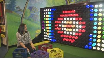 Avista electricians build giant Lite Brite for Mobius Children's Museum