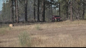 Crews work to mop up reservation road fire