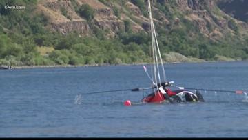 Helicopter sinks to bottom of Snake River after crash, men leave the scene