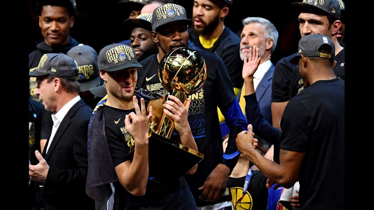 Jun 8, 2018; Cleveland, OH, USA; Golden State Warriors guard Klay Thompson (11) reacts with celebrates with the Larry O'Brien Championship Trophy after beating the Cleveland Cavaliers in game four of the 2018 NBA Finals at Quicken Loans Arena. Mandatory Credit: Ken Blaze-USA TODAY Sports