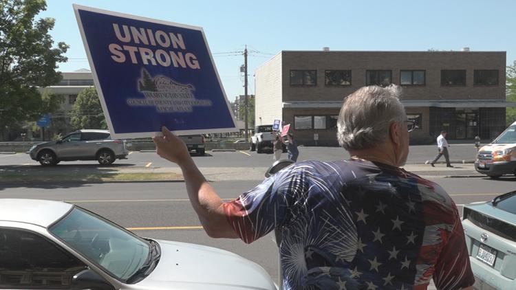 Spokane employees picket in dispute over public negotiations