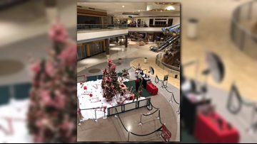 'In the middle sits lonely Santa'   Photo shows Santa waiting for children to visit