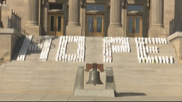Cancer advocates light up the Idaho Capitol steps with a message of hope