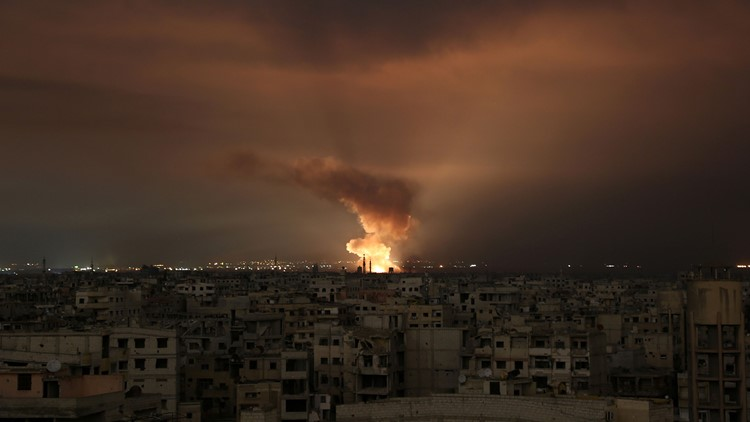 Smoke billows following a regime air strike on the besieged Eastern Ghouta region on the outskirts of the capital Damascus, late on February 23, 2018.