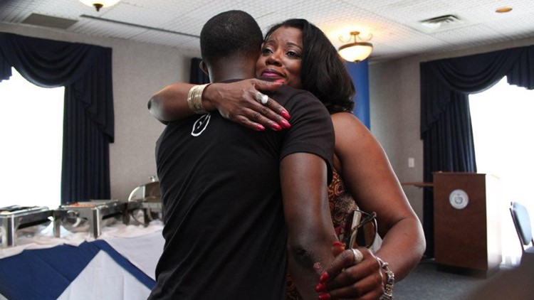 Renee Hampton, aunt of Sharita Henderson, who was injured in the Waffle House shooting, hugs James Shaw, Jr.