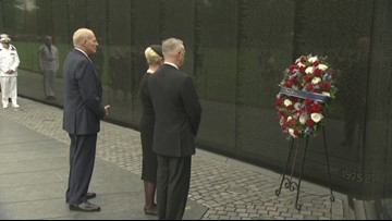 Hundreds gather to lay wreaths on veterans' memorials